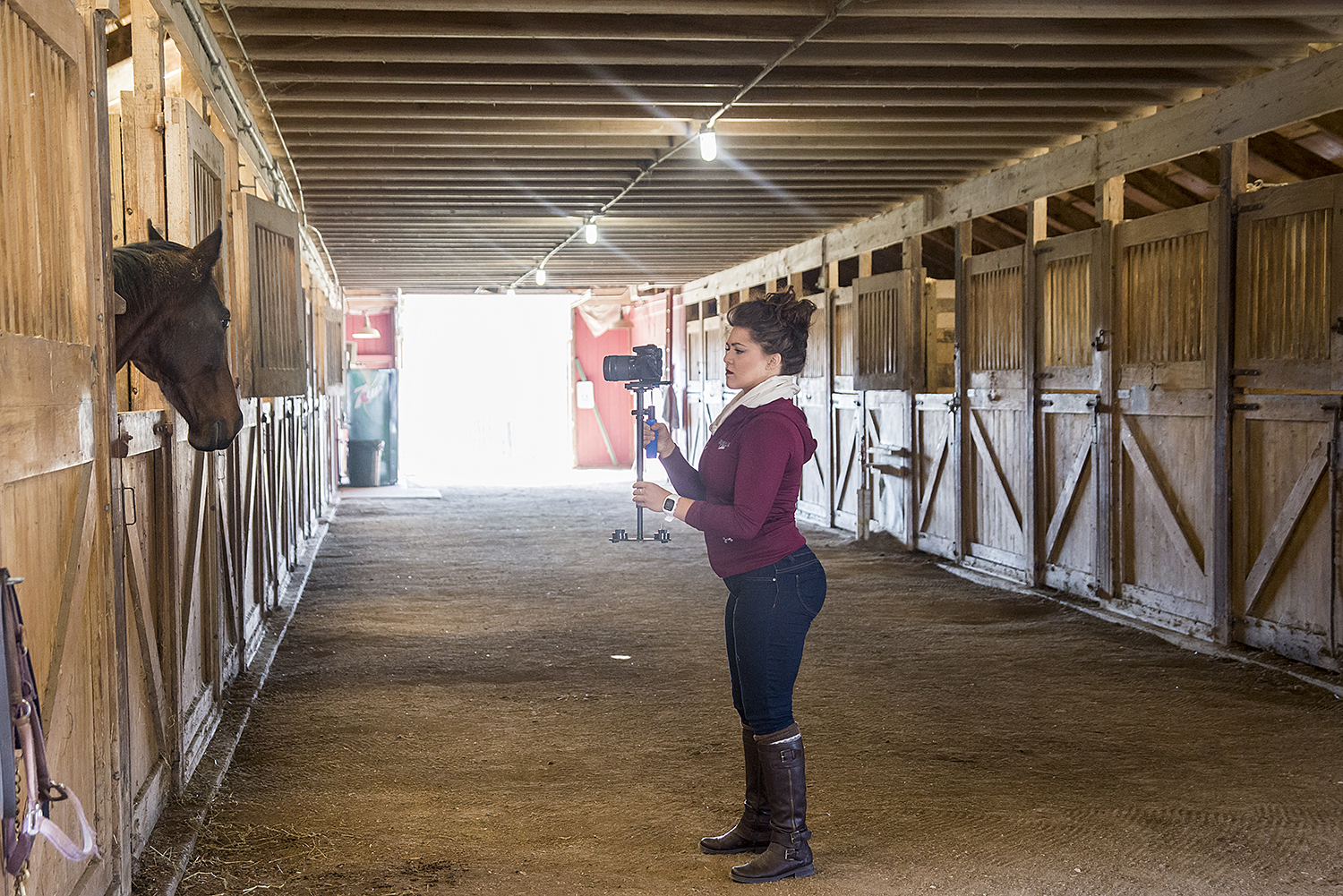 Foundation videographer, student Amanda Neuhouser films at the SIU Equine Center at university farms.