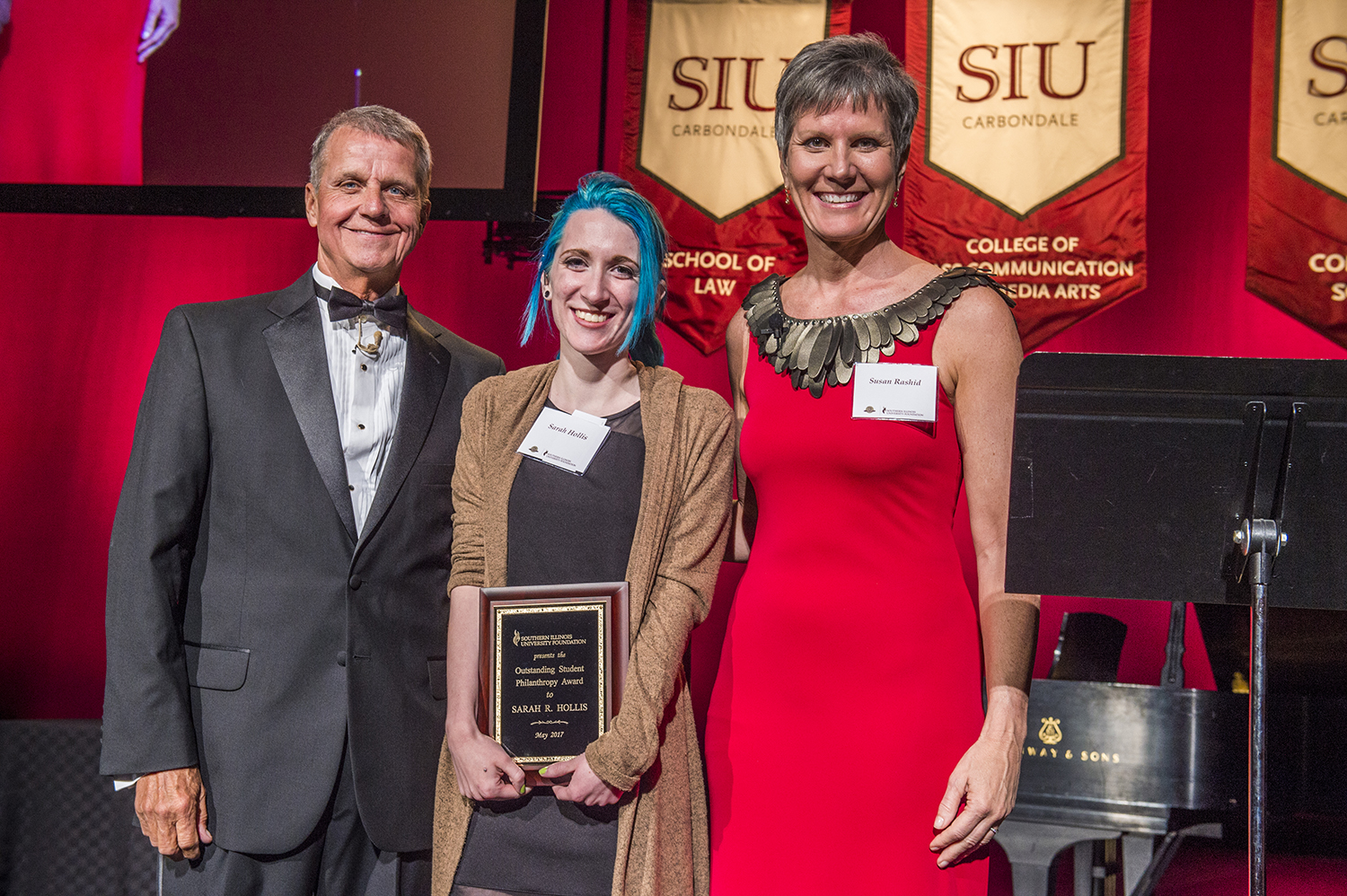 Sarah Hollis is the first recipient of the SIU Foundation's Outstanding Student Philanthropy Award. Roger Tedrick, SIU Foundation board president, and Susan Rashid, SIU Foundation board president-elect, presented Hollis with this award at the SIU Foundation 75th Anniversary Celebration on May 6, 2017.