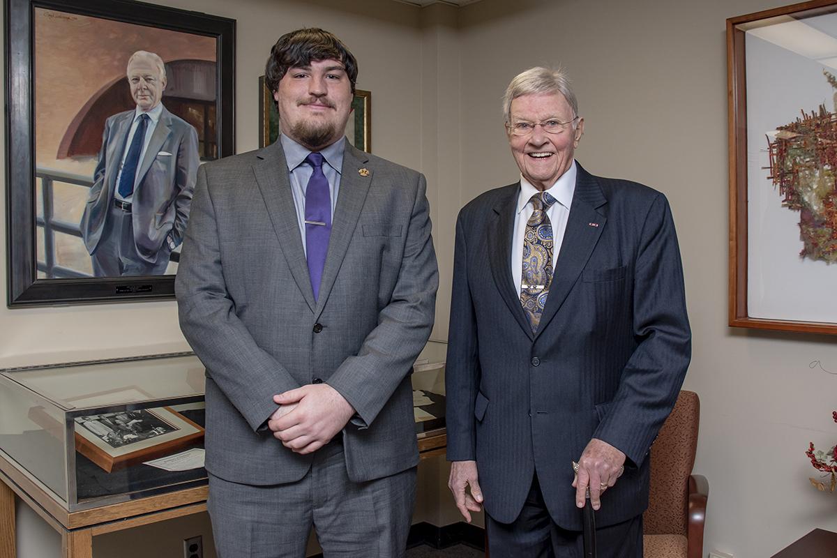 Pictured left to right: scholarship recipient Aaron Herkert and Judge Richard Mills
