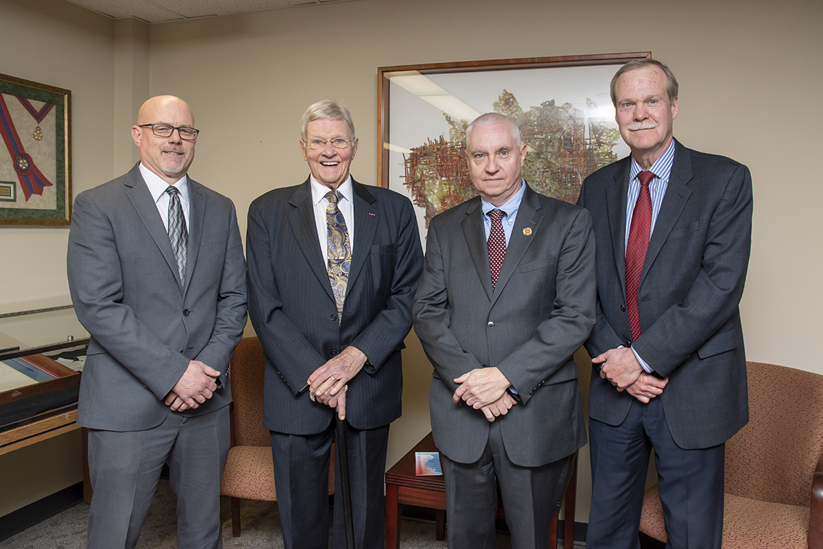 Judge Richard Mills is pictured with three of his former law clerks. Left to Right: Tom Patton, Tom Wilson, Judge Mills and Judge Stuart Borden.