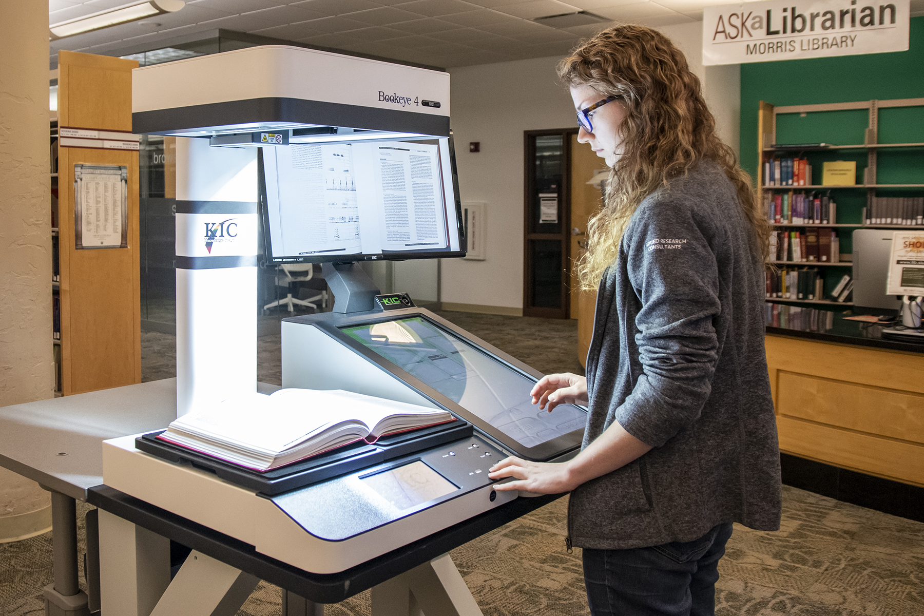 Student uses SIU Morris Library SIU Morris Library Knowledge Imaging Center Bookeye 4 system